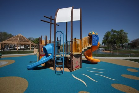 Spiral slides can be small like the one connected to the right of this ship shaped playground, or much, much larger.